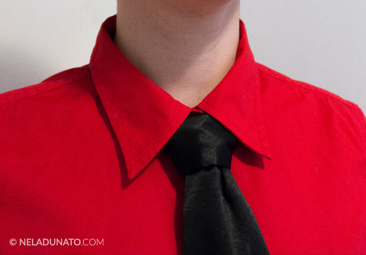 Red shirt & a black tie