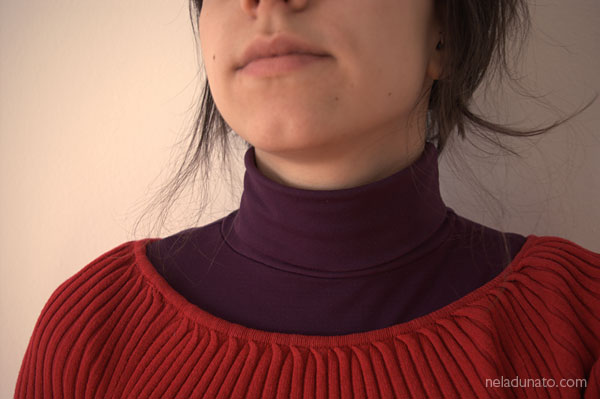 Red sweater over a purple turtleneck